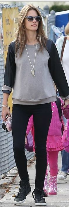 Who made  Alessandra Ambrosio's black skinny jeans and buckle sneakers?