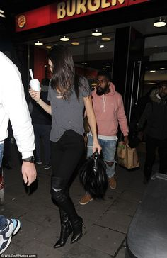 Welcome to London! Kendall looked typically gorgeous for the night out, teaming spray-on black skinny jeans with over-the-knee leather boots with a towering heel