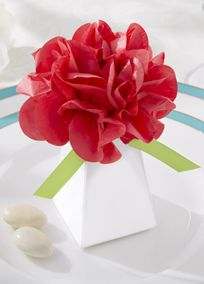"""What an enthusiastic thank-you gift! Go elegant or casual with our pretty pink tissue-paper pom pom-topped favor box. You must admit this is one of the most cheerful favor boxes you've ever seen!  Features and Facts:   White pillar-shaped favor box topped with hot-pink tissue-paper pom pom and vibrant green-satin ribbon accents.  Favor box measures approximately 5""""H with pom pom (pom pom measures approximately 3"""" in diameter; favor box measures 2 3/4""""H x 1 7/8"""" square at the ..."""