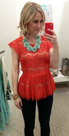 Red lace peplum top with green statement necklace