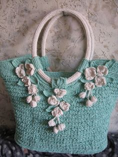 Very nice colors on this bag - I think they crocheted around some large cording for the handles (make sure to hide the seams in the sections of the bag that holds the handles to the bag) *Inspiration*