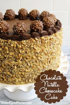 "Chocolate Nutella Cheesecake Cake by Wicked Good Kitchen. This special ""cheesecake cake"" is made with moist and tender Chocolate-Hazelnut Velvet Cake layers made flavorful with the addition of hazelnut oil and hazelnut liqueur (Frangelico®) or syrup enveloping a heavenly Nutella Cheesecake layer with a mousse-like ""light as a cloud"" texture. Our Chocolate-Nutella Cream Cheese Buttercream was an ideal match to frost both this layer cake and cheesecake. It is especially light and silky while…"