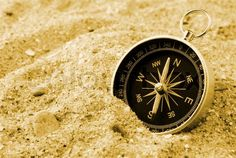 "Buy the royalty-free Stock image ""The compass showing a direction, lies on sea sand"" online ✓ All image rights included ✓ High resolution picture for pr. High Resolution Picture, Compass, Ocean, Sands, Rebel, Collage, Image, Book, Collages"