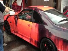 A Nissan Skyline painted with heat sensitive color changing paint.