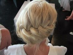 Angled French braid updo.