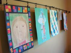 I think i've found my artwork display solution for the playroom...Curtain rod and curtain clips! awesome!