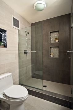 I like the color scheme.  modern walk in shower small bathroom near wood floor - Bing Images