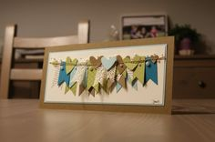 banner strips sewn on; vintage paper and lace strips; pearl sprinkles; small sentiment in corner