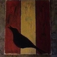 Black bird on boards