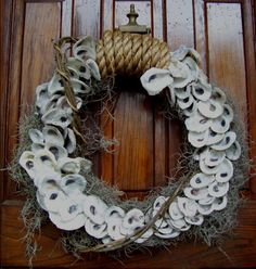 Oyster Shell Door Wreath  Hand made with resources from the Gulf Coast  Oyster shells harvested this season  Details:  http://www.backwaterstudio.com/oyster-shell-door-wreath.html
