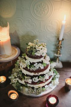 Naked three tier red velvet cake decorated with white flowers  | Photography by http://jesspetrie.com/
