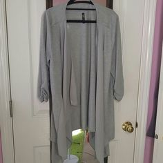 Gray open cardigan Lightweight knit fabric with two inserts that drape down the front. Sweaters Cardigans
