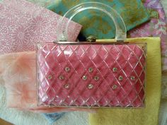 Vintage lucite purse pink weved like this in harveys