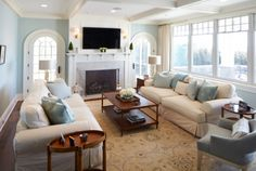 The light blue on the walls used with the white on the trim takes my breath away.  From House of Turquoise blog.