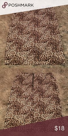 """Animal print pencil skirt Animal print skirt. Pencil style. Zipper closure. Slit in back. Stretchy. Not lined. Thick material. Length: 24"""". Waist: 16"""". Hips: 19.5"""". Slit: 6.5"""". Alfani Skirts Pencil"""