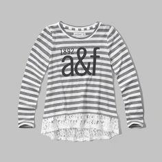 a comfy T-shirt with girly lace hem, featuring graphic at front with logo detailing, a crewneck, easy fit, imported<br><br>60% cotton/ 40% polyester