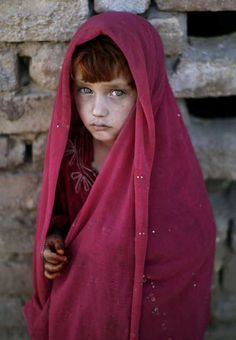 "freeafghanistan:    Afghan refugee girl, laiba Hazrat, 5, stands next to her home while she and other children, not pictured, celebrate the Muslim holiday of Eid al-Adha, or ""Feast of Sacrifice"", on the outskirts of Islamabad, Pakistan, Sunday, Oct. 28, 2012. (AP Photo/Muhammed Muheisen)"