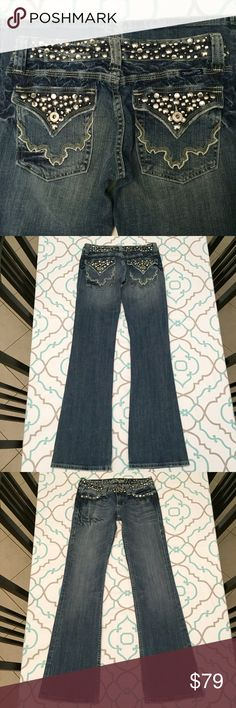 "GORGEOUS MISS ME FLARE JEANS 27 A simply stunning pair of pre loved and well cared for Miss Me jeans. Bling and studs are GORGEOUS! Minor wear of pocket edges. Very minimal wear to bottom of pant legs. I love the tie dye batik like crinkle texture! 33"" inseam. 7"" rise. 14"" flat across the back. 98% cotton. 2% polyurethane. Very slight stretch. Medium Blue Wash. Flare Leg. Low Rise. Ask me any questions! Love 'em? Like 'em! Get 'em before they're gone! Miss Me Jeans Flare & Wide Leg"