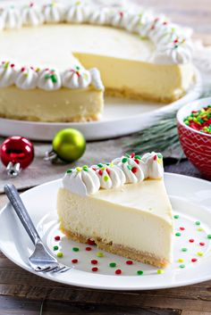 Sugar Cookie Cheesecake - My Baking Addiction Sugar Cookie Cheesecake is sweet, creamy and deliciously festive for the holidays! Sugar Cookie Cheesecake, Cheesecake Recipes, Christmas Cheesecake, Christmas Desserts, Baking Recipes, Cookie Recipes, Dessert Recipes, Holiday Baking, Christmas Baking