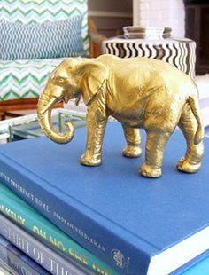 Rustoleum spray paint in Brass gives this finish.  Use random finds from thrift stores or buy plastic animals and use for accents on bookshelves.  Also in this blog post, glue to something heavy to create bookends.