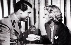 Jean Harlow & Cary Grant share a cup of coffee