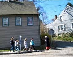 Docent and school children, passing the Jared Bartheleme House (c. 1798), Ansonia, Connecticut.