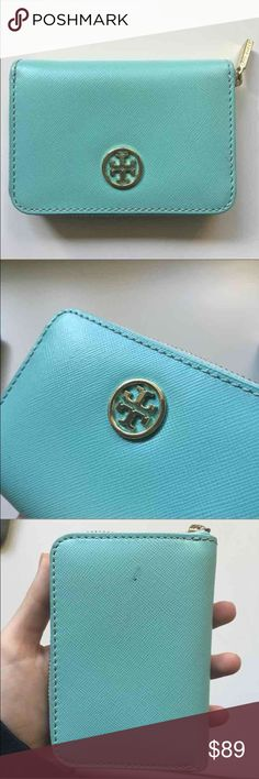 Tory burch mini wallet keychain Aqua blue/mint blue with gold logo. Barely used. Small spot on the back shown in picture. $200 new Tory Burch Bags Wallets