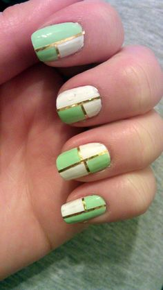 Fun mint and white mani with gold striping tape.