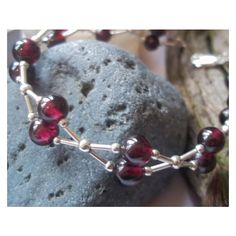 "Deep Red Garnet and Sterling silver ""Kiss"" Bracelet ❤ liked on Polyvore featuring jewelry, bracelets, sterling silver bangles, sterling silver jewellery, wide bangle, red garnet jewelry and i love jewelry"