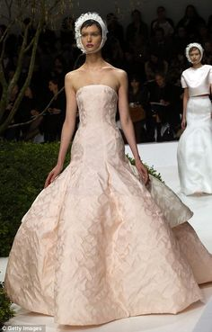 One of the final looks in white saw the bottom of one silk ball skirt expand out at a line, like an organic growth spurt