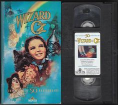 "THE WIZARD OF OZ (50TH ANNIVERSARY EDITION) (1939): VHS Videotape, tape has been viewed and is in very good condition, MGM/UA Home Video M301656, 1989 release, approx. 119 minutes (plus bonus material), Rated G, Sepia Tone & Color, Hi-Fi Stereo Audio, Closed Captioned, Box cover is in very good condition with the booklet still bound inside the front cover flap. Glue residue spot on the side of the cassette where the ""proof"" sticker was attached. Limited Edition copy with a 32-page booklet…"
