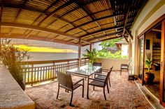 On a cliff overlooking the beach at Ko Lanta, south of Krabi. Nearby restaurants. You can walk to the beach. Only 2 bedrooms, but it lists 7 beds.