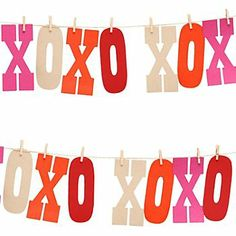 Another bunting idea: make an XOXO garland, using a stencil (or buying this kit at Paper Source) but cover with pink & gold glitter. Like the idea of hanging it on twine with mini clothes pins.