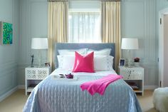 blue and pink bedroom design with paneled walls, modern crystal lamps and white mirrored end tables; modern bedroom design ideas; bedroom lighting