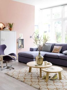 How To Decorate With Blush Pink - Decoholic - fresh Living Area with dark sofa and pink blush wall - L-shaped Couch / Seating