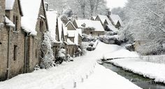 We were just here, but I'd love to see it covered in snow like this! Arlington Row - Bibury, England