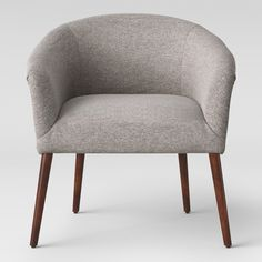 Modern style meets comfortable design in the Barrel Chair from Project 62™. The upholstered chair has a barrel backrest that curves into armrests, a wide foam cushioned seat, back and sides, and cylindrical tapered legs. This is a unique mid-century modern chair that will update any room.<br><br>1962 was a big year. Modernist design hit its peak and moved into homes across the country. And in Minnesota, Target was born - with the revolutionary idea to celebrate design for...