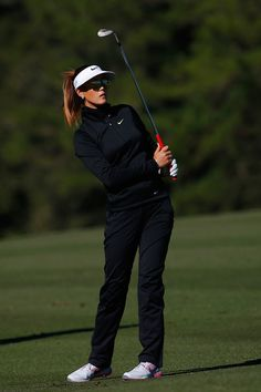 Michelle Wie Photos Photos - Michelle Wie watches her second shot on the 16th hole at the Coates Golf Championship Presented by R+L Carriers - Round One at the Golden Ocala Golf & Equestrian Club on January 28, 2015 in Ocala, Florida. - Coates Golf Championship: Round 1