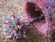 "Knitted Twiddle Muff by ""settermom"" on Knittingparadise.com; knitting pattern found at: http://www.whh.nhs.uk/_store/documents/twiddlemuffsknittingpattern.pdf"