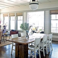 Love the open floor plan for the dining to look not into the living space but through the large windows to see the view. LOVE it. That table is great, sturdy looking.
