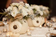 Table Look Option #3--a beautiful arrangement in your colors/flowers could be designed inside a pumpkin; $75 & up depending on size; the white pumpkins or even the fairy tale variety that are more muted and softer oranges would be nice, there are even grey/blue ones