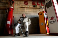 """Collector Bill Triplett takes a breather in one of the garages housing some of his antiques. Triplett was featured last month in an episode of """"American Pickers,"""" a reality show on the History Channel that features people hunting down valuable items in garages and barns."""