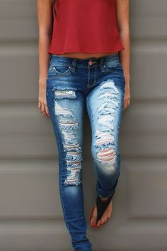"These Loved N' Torn skinny jeans will ever so slightly lift and shift your bum to give you a firmer look! Yay! This rip and tear style achieves an edgy and trendy look. The model is 5'3"" and is wearin"
