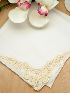 """Set of 3 Ivory Battenburg Lace Loop Corner Handkerchiefs This is a set of 3 ivory wedding handkerchiefs with a lovely battenburg lace loop corner.    Each handkerchief has hand rolled edging and a beautiful Battenburg lace looped design in one corner.   Each handkerchief is 100% cotton and measures approx 12"""" by 12"""" square.    Perfect for the bride or ideal for small gifts for any occasion."""