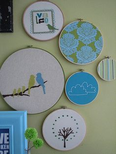 "embroidery hoop wall display; a different twist on the standard ""fabric in a hoop"" display"