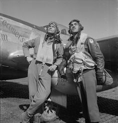 "Tuskegee Airmen Col. Benjamin O. Davis and Edward C. Gleed in Ramitelli, Italy in March 1945. Col. Davis was the Commanding Officer of the 332nd Fighter Group. Mr. Gleed was Group Operations Officer. P-5/D, ""Creamer's Dream,"" is in the background. Photo by Toni Frissell."