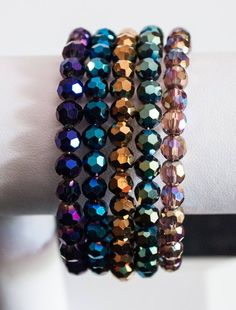 Multi colored metallic beaded memory coil bracelet