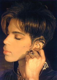 Prince with his really Cool Pretty Ear Cuff.