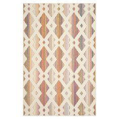 Anchor your living room seating group or define space in the den with this artfully loomed rug, featuring a trellis motif on a striped background.
