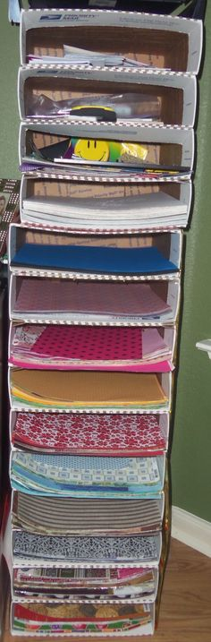 Organizing scrapbook paper EASY.... simply used Medium sized priority flat rate shipping boxes and stacked them one on top of the other, then covered in my choice of wrapping paper for design. Make as many or few as needed.
